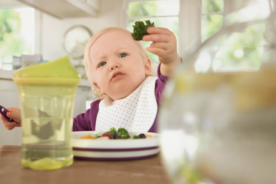 Girl_holds_broccoli_small
